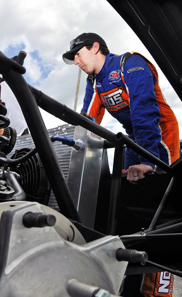 Kyle Busch takes a look Thursday at the car that he will drive July 24 in his third attempt to win the TD Bank 250.