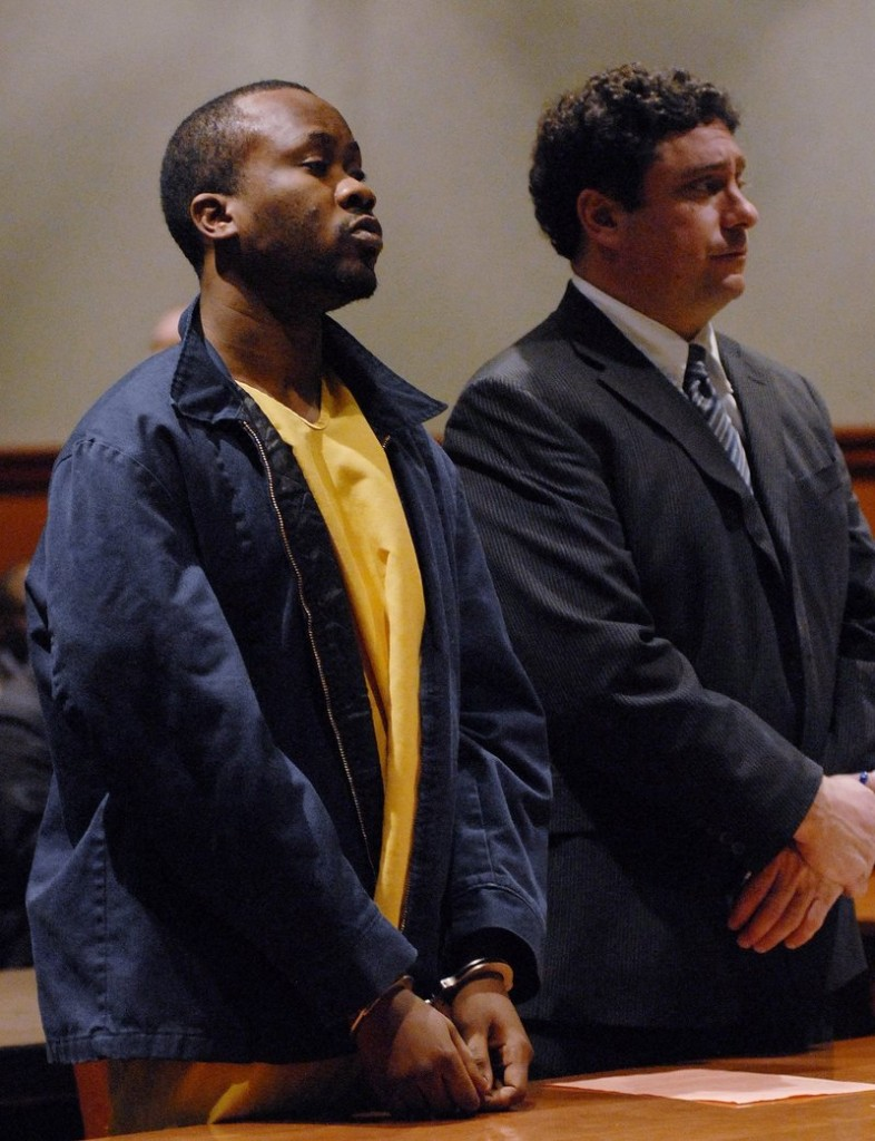 Daudoit Butsitsi stands next to his attorney, Anthony Sineni, at a hearing in February 2010.
