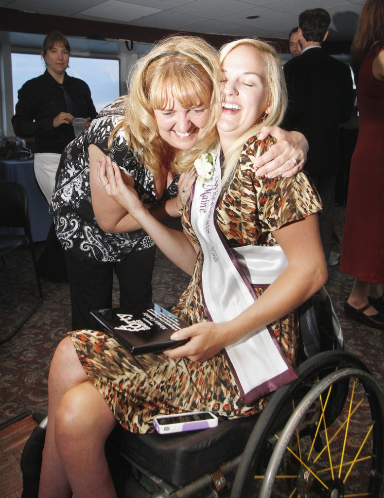 Monica Quimby, Ms. Wheelchair Maine 2011, gets a hug from her mother, Nadia Elliot of Turner, at a celebration on July 14. Quimby, 25, of Scarborough, is one of MaineToday Media's Forty Under 40 emerging leaders.