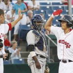 Chi-Hsien Chiang, right, is met by Alex Hassan after hitting a two-run homer in the fourth inning for the Sea Dogs.