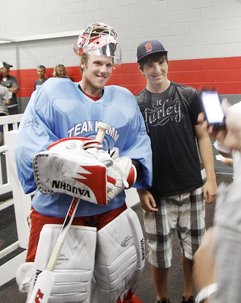 Former UMaine and current Detroit Red Wings goalie Jimmy Howard, left, and Brunswick High goalie Jason Blier were among the 40 players who attended a fundraiser for brain injury-related research Sunday.