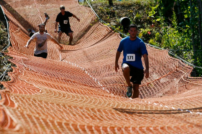 Competitors cross one of 16 obstacles in the Tough Mountain Challenge.