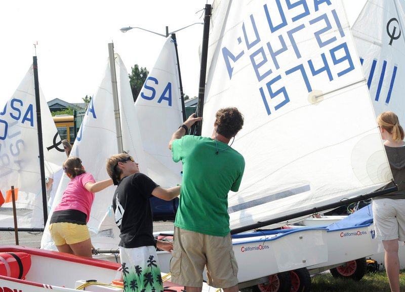 Twelve-year-old Joe Hawley and his father Rob Hawley of South Portland get ready to race their Optimist class boat.