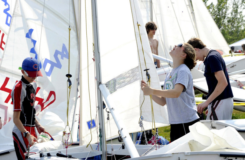 Fourteen-year-old Toni Rerisi of Manchester, Mass., gets her 420 class sailboat ready to race.