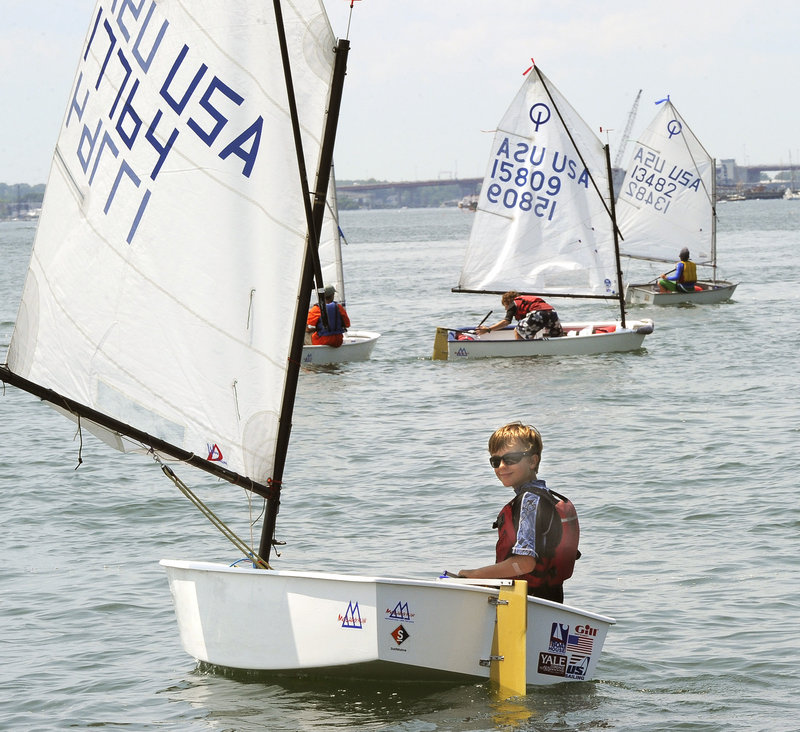 Caleb Robinson, 11, of Falmouth jockeys for position as he waits for the signal to start the Optimist class race Tuesday.