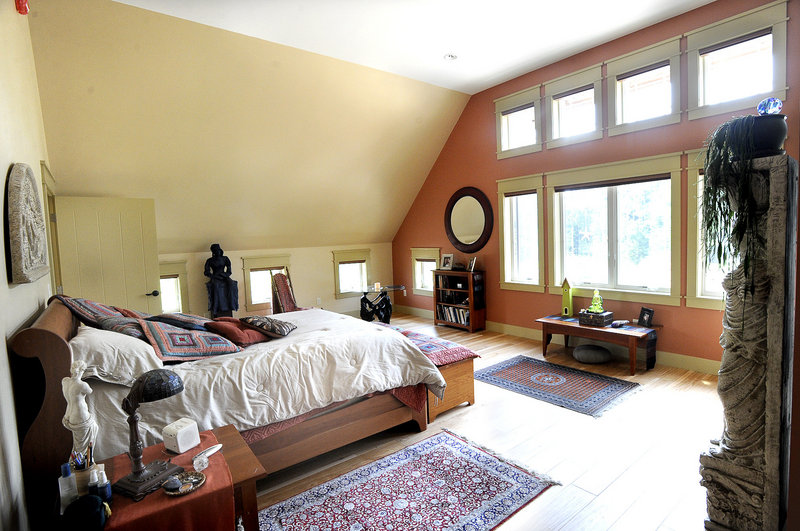 A wide wall of windows in Paradis' master bedroom captures the sun's heat.