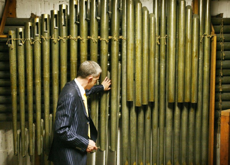 Ray Cornils, Portland's municipal organist, inspects the Kotzschmar organ, which has been housed in Portland City Hall's auditorium since 1912. It will remain in use up to its 100th anniversary on Aug. 22, 2012.