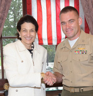 Sen. Olympia Snowe welcomes Marine Corps Capt. David J. Cote of Bangor to Washington in this undated photo. Cote has been named Military Times' 2011 Marine of the Year.