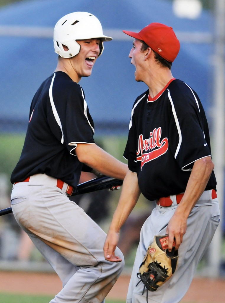 Brendan Horton of Morrill Post, left, celebrates with Paul Reny after scoring the go-ahead run in the eighth inning Thursday in the 10-9 victory against Andrews Post in the Zone 4 championship game.