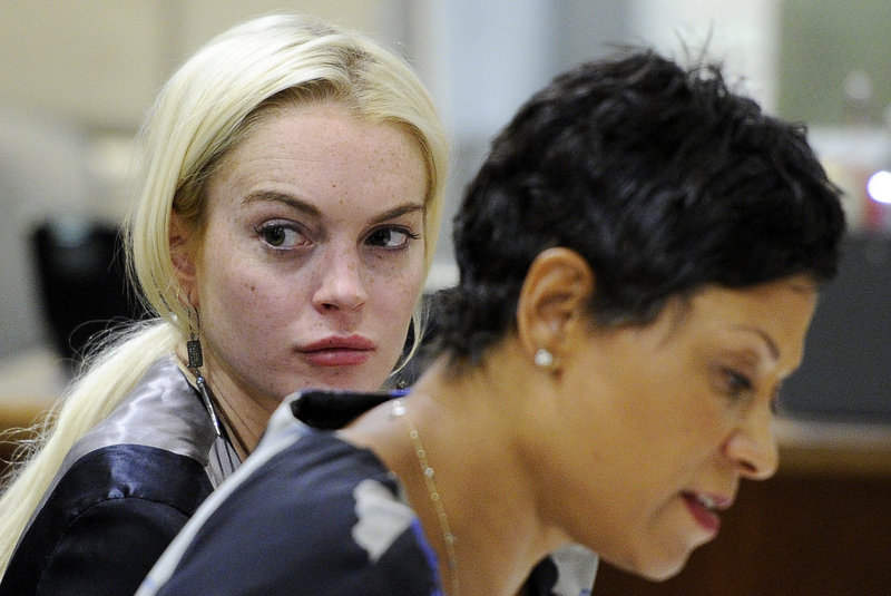 Lindsay Lohan is pictured with her attorney during a hearing on Thursday. A judge said she needs to speed up her community service.