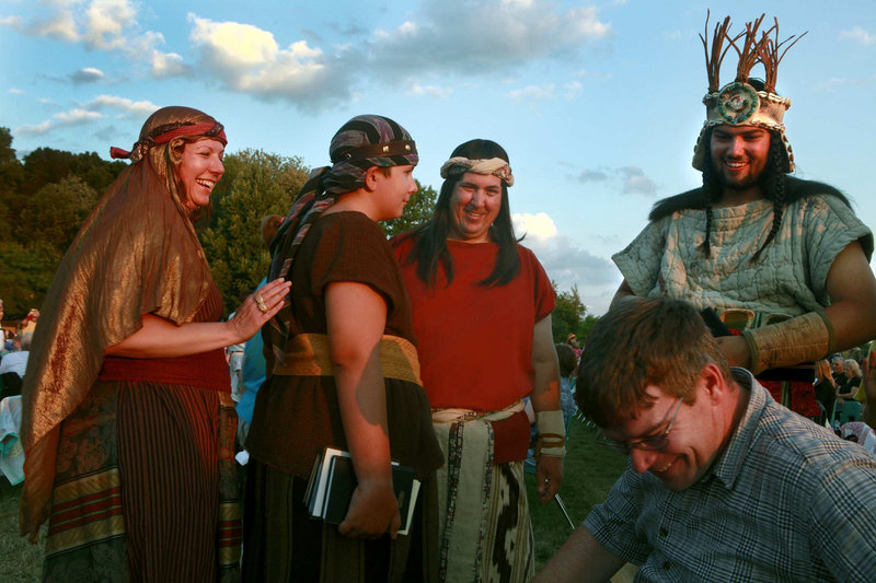 Lee Preston, left, and her husband, Don Preston, in the red shirt, get ready to take part in the Hill Cumorah Pageant, an annual Mormon religious re-enactment of the story of Jesus – and the Book of Mormon – in Palmyra, N.Y. Their son John, second from left, also played a role in this year's performance, which involved 700 volunteers.