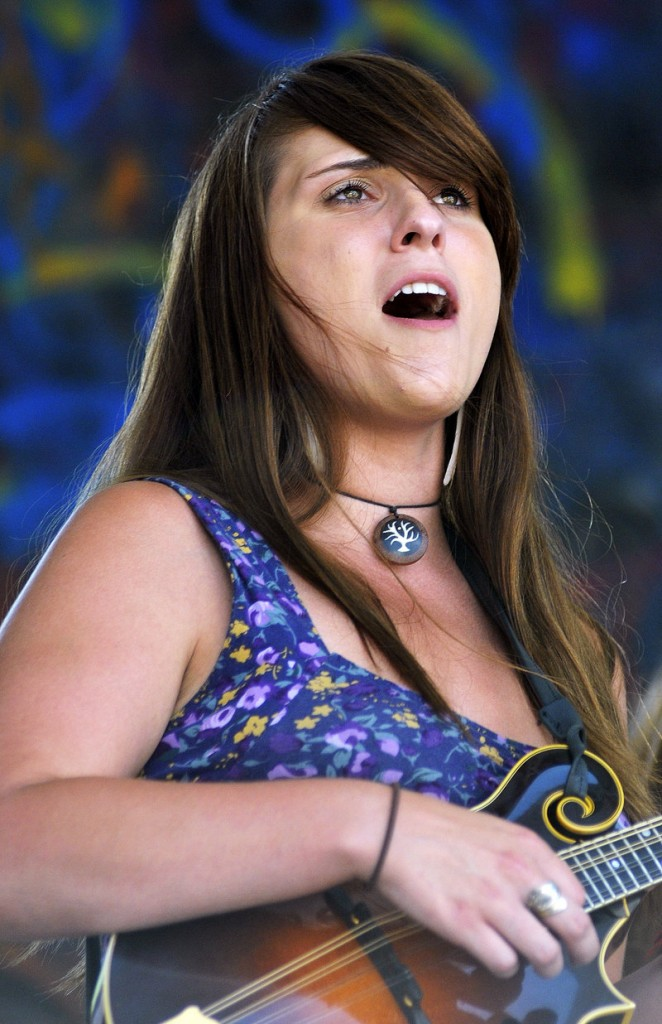 Suzy Oleson, a mandolin player with Chasing Blue, sings during the band competition.