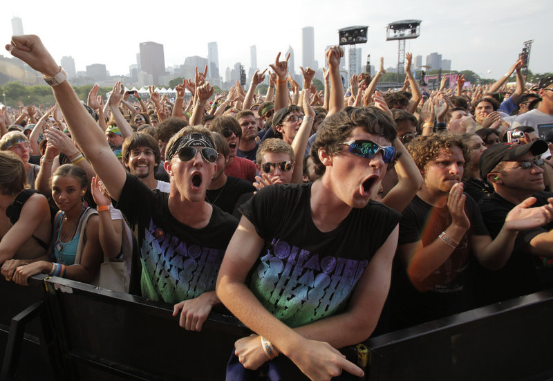 Fans watch Wolfmother's performance at the Lollapalooza music festival in Chicago in August of last year. YouTube will live stream Lollapalooza and Austin City Limits this summer; in the past it has streamed other festivals, including Bonnaroo in Tennessee.