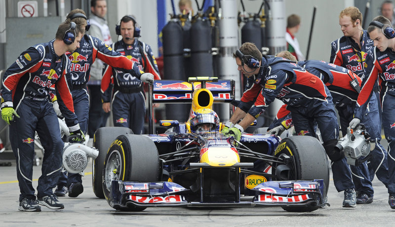 Mark Webber makes a pit stop Saturday during qualifying for the Formula One series German Grand Prix in Nuerburgring, Germany. Webber edged McLaren driver Lewis Hamilton to win the pole with a qualifying time of 1 minute, 30.079 seconds around the 3.2-mile circuit.