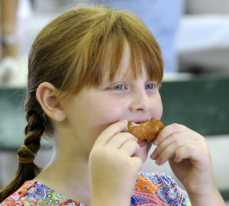 Leah Wimpfheimer, 8, samples a saucy delicacy entered in the People's Choice competition.