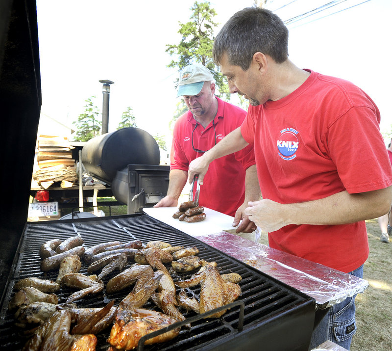 Scott Carter and Brian Douglass from Steep Falls prepare an entry Saturday during the Western Maine BBQ Festival. Forty teams from Maine, New England and as far away as Florida are grilling their best this weekend in pursuit of prizes totaling $12,500 in a variety of categories.
