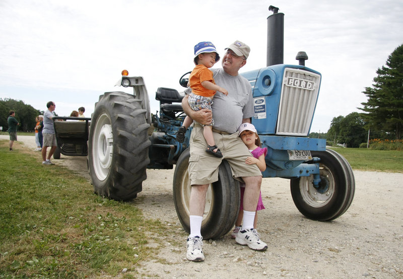 Gary Kerns of Topsham visits Wolfe's Neck Farm with his grandchildren Liam Jessie, 2, of Topsham and Paige Kerns, 4, of Bangor.