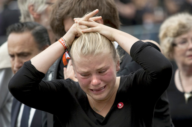 A woman weeps at a memorial service at Oslo Cathedral on Sunday for the victims of Friday's attacks. Norway's king and queen attended the service, themed