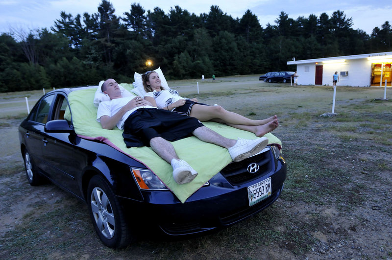 Chris Lamb and Shannon Noyes of Scarborough await the start of the movie at the Saco Drive-In on Route 1 in Saco on Friday.