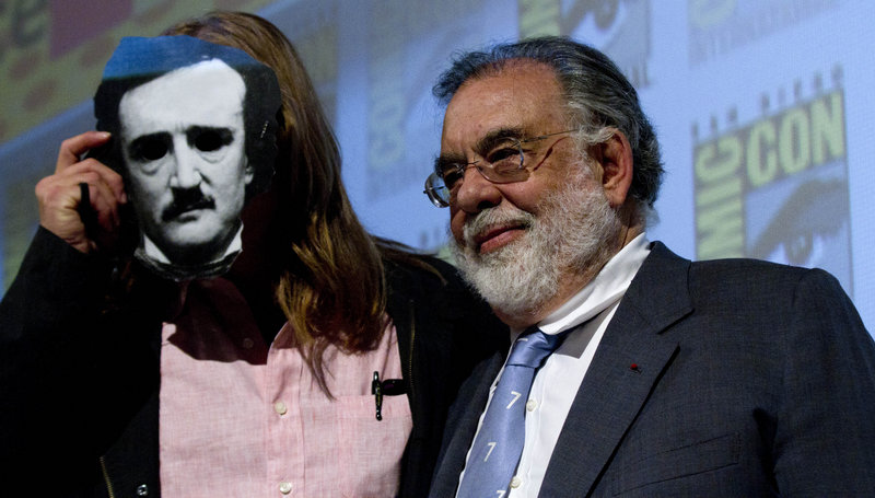Francis Ford Coppola stands with Val Kilmer, who wears a 3-D mask in the image of Edgar Allen Poe.