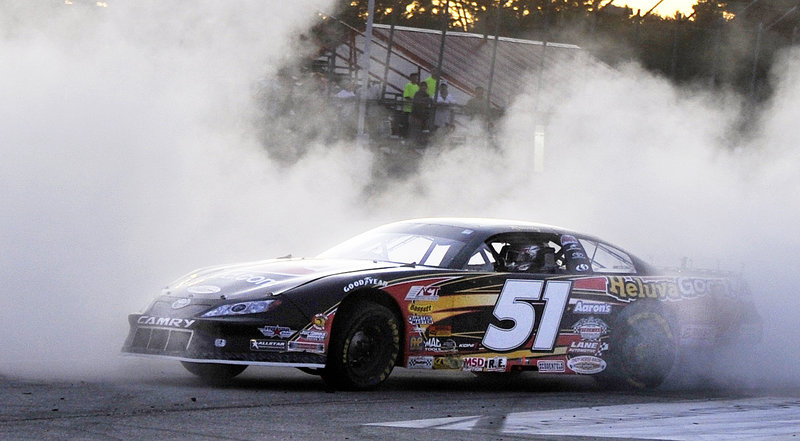 Kyle Busch burns a little rubber in celebration of winning the TD Bank 250 on Sunday night at Oxford Plains Speedway. Busch picked up his first win in the race after unsuccessful bids in 2005 and 2006.