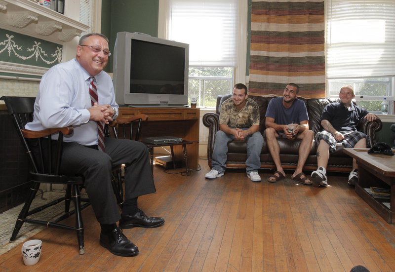 Gov. Paul LePage visits with residents of Serenity House. About 150 men are treated for addiction there each year and transition back into the community over three months. Serenity House gets about $376,000 each year from the state.