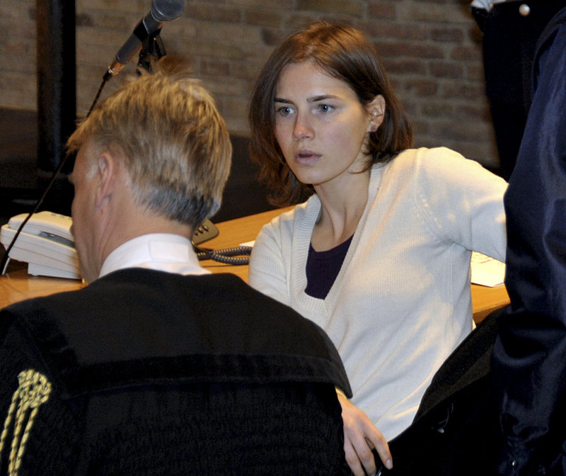 Amanda Knox talks with her attorney, Carlo Dalla Vedova, as she arrives to attend a hearing in her appeal trial in Perugia, Italy, on Jan. 22. Last year, the American woman was convicted of the murder of her British roommate, Meredith Kercher, and sentenced to 26 years in prison.
