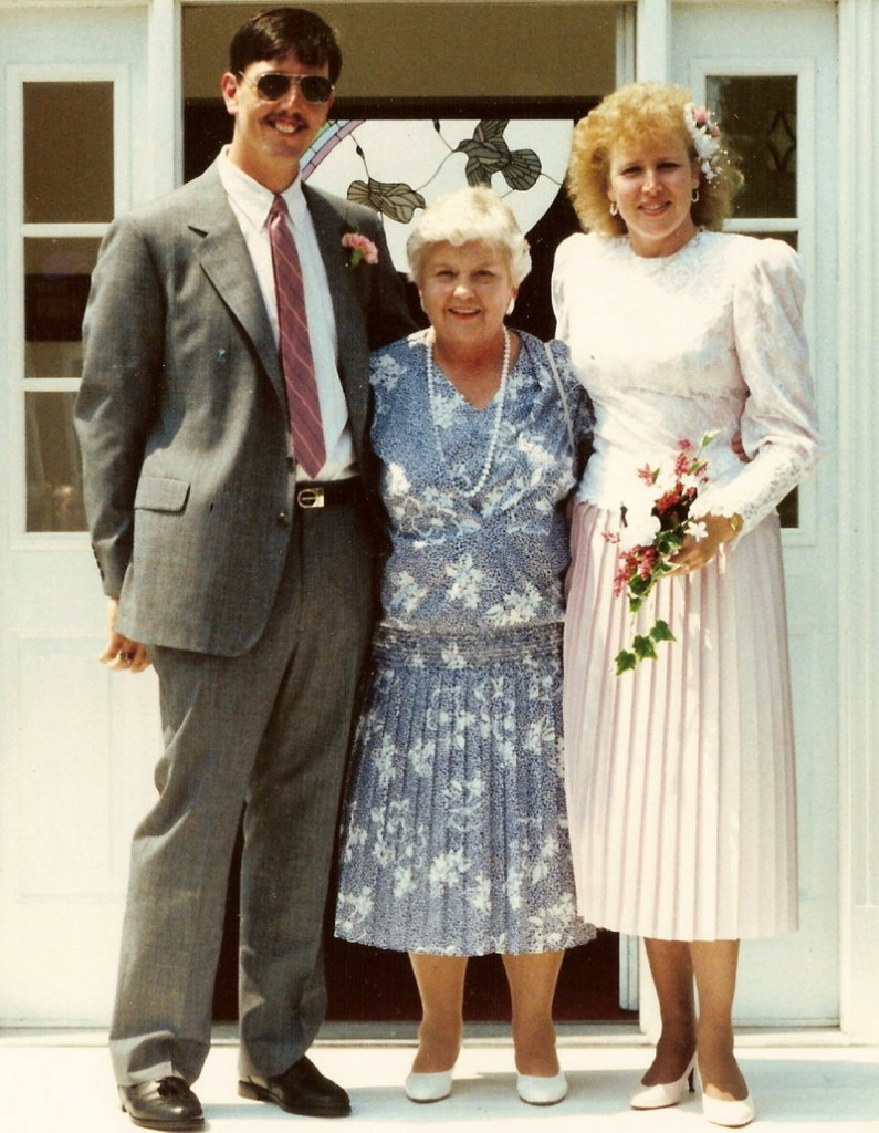 Myrtle Storer, center, poses with newlyweds Penny Cary, her stepniece, and Hosea Carpenter at their wedding on July 22, 1989.