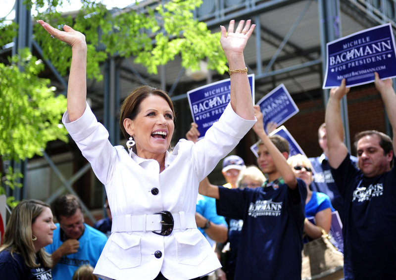 Rep. Michele Bachman, R-Minn., acknowledges the crowd at a rally last week in downtown Aiken, S.C. Often critical of government subsidies, her personal finances have come under scrutiny for accepting farm and business subsidies.