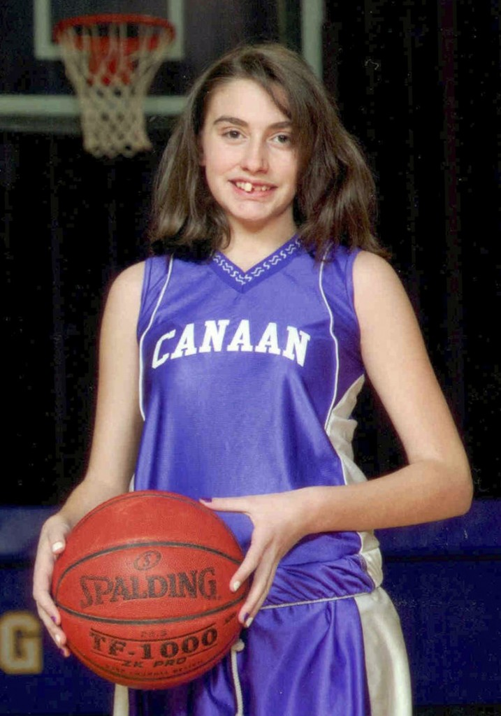 This 2010 photo shows Celina Cass of West Stewartstown, N.H., in a basketball team uniform in neighboring Canaan, Vt.