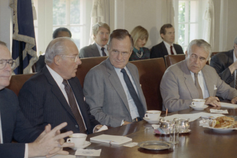 President George H.W. Bush, center, met with congressional budget leaders, including Reps. Bob Michel, R-Ill, left, and Benjamin Gilman, R-N.Y., at the White House in 1990. The country endured months of bickering and brinksmanship before Congress passed the biggest deficit-reduction packages in American history.