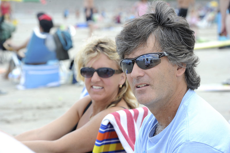 Sue-Anne and Scott Rae of Montreal spend time at Ogunquit Beach last week. Maine's beaches are so popular among Canadians that radio stations where they live air York County weather forecasts, the Raes said.