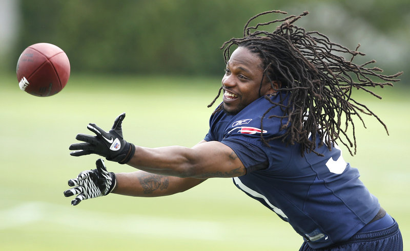And finally it's time for football. More than 3,000 fans welcomed the New England Patriots to their first day of training camp Thursday at Foxborough, Mass. Smiles were everywhere and footballs were flying, with safety Brandon Meriweather reaching for one of them during practice.