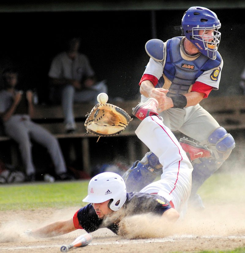 Gayton Post catcher Hyde McKee has the ball and glove knocked away Thursday as Ryan Edwards of Augusta barrels into the plate during Augusta's 21-11 win in the Legion tourney.