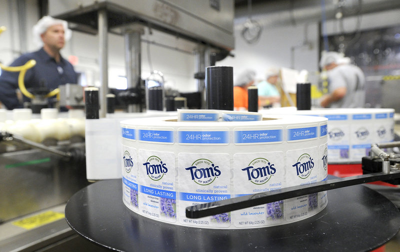 Labels are affixed to deodorant bars at Tom's of Maine in Sanford. The company's first product was laundry detergent.