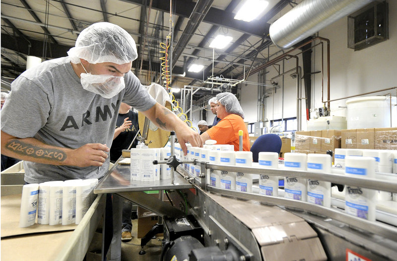 Brooks Hobbs works on the deodorant line at Tom's of Maine in Sanford. The company's products are made from natural ingredients.