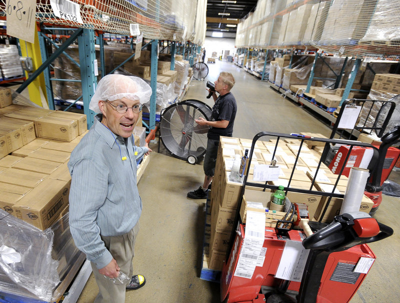 Bill Hetzel, plant manager, stands in the product warehouse of Tom's of Maine in Sanford. He likens some of the ingredients to fine wines – expensive and sourced from specialty suppliers.