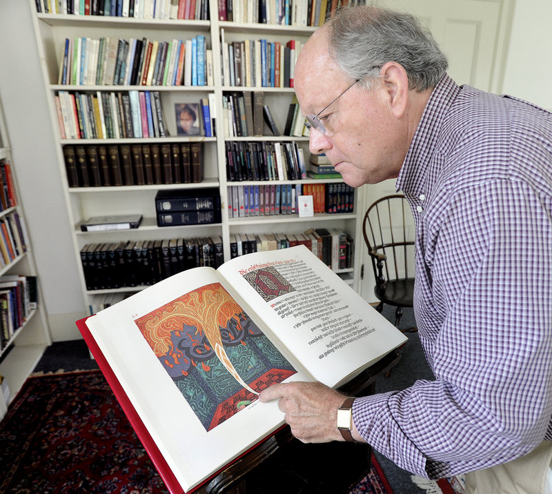 """Paul Huss looks at the """"Red Book"""" at the Maine C.G. Jung Center in Brunswick. """"This ... is a place for kindred spirits who come from very diverse backgrounds,"""" he said."""