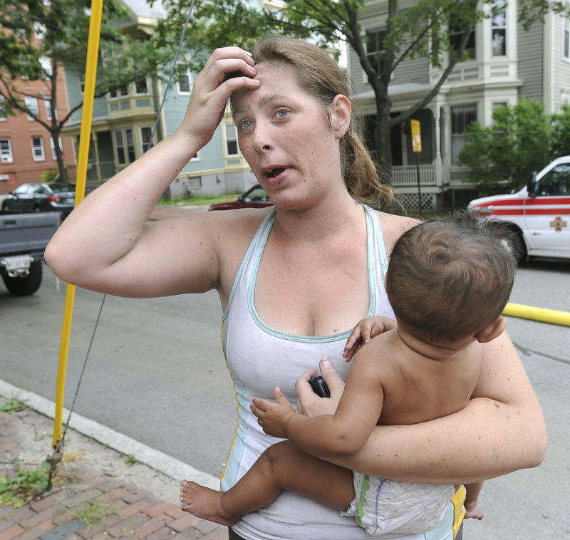 """Chasity Holtan, victim of fire: """"I was hanging there a good 10 or 12 minutes before firefighters got me."""""""
