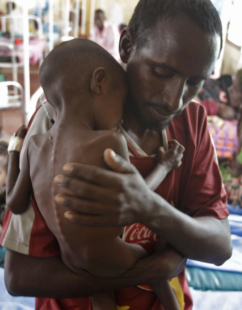 Adam Ibrahim is held by his father, Abdulle Ibrahim, at the International Rescue Committee in Dadaab, Kenya.