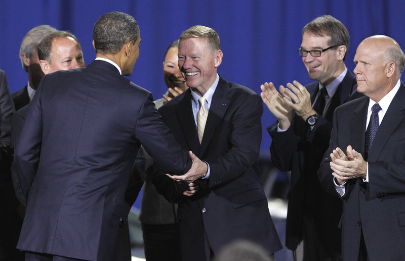 President Obama greets Alan Mulally, president and CEO of Ford, in Washington on Friday, where he announced new fuel efficiency standards for cars and light trucks.