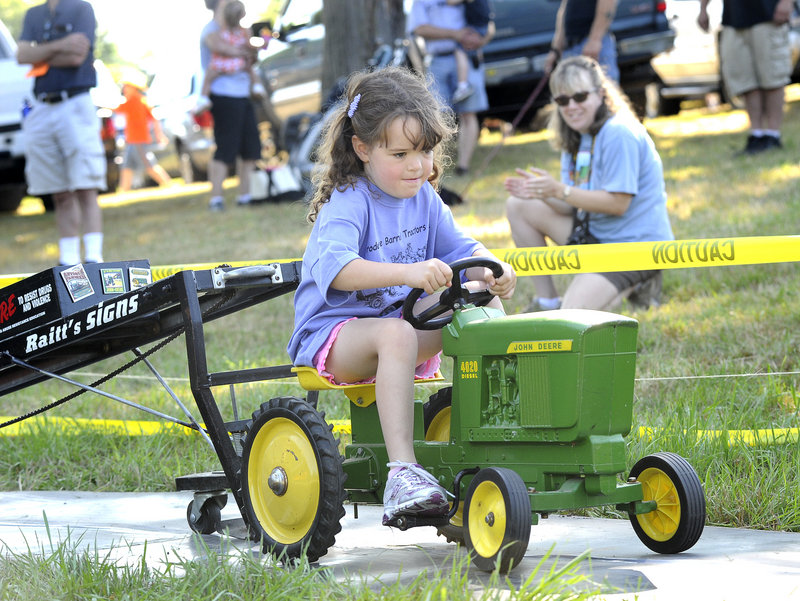 """Six-year-old Caroline Chessie of Shapleigh gets down to business in the """"pedal pull"""" Saturday at the Eliot Antique Tractor & Engine Show."""
