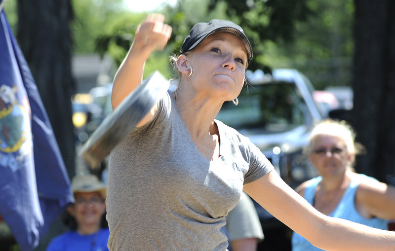 Angie Littlefield of Wells tosses a 3.5-pound skillet 60 feet in the annual women's competition.