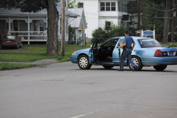 AT THE SCENE: An officer with the Maine State Police responds Saturday evening to a standoff on Weston Avenue in Madison. The man who refused to leave his home, Rodney Thibodeau, 53, was eventually arrested on a charge of domestic violence assault after his mother pursuaded him to come outside.
