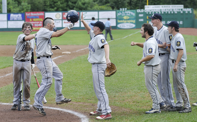 Pat Parker of Bedford Post celebrates with his teammates after hitting a home run Monday against Whitestown, N.Y., during the American Legion Northeast Regional final.