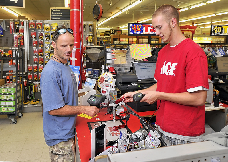 Dan Kelleher buys LED flashlights for his family in Scarborough from Ace Hardware sales associate Eric Cobb Friday in preparation of the approaching severe storm on Sunday.
