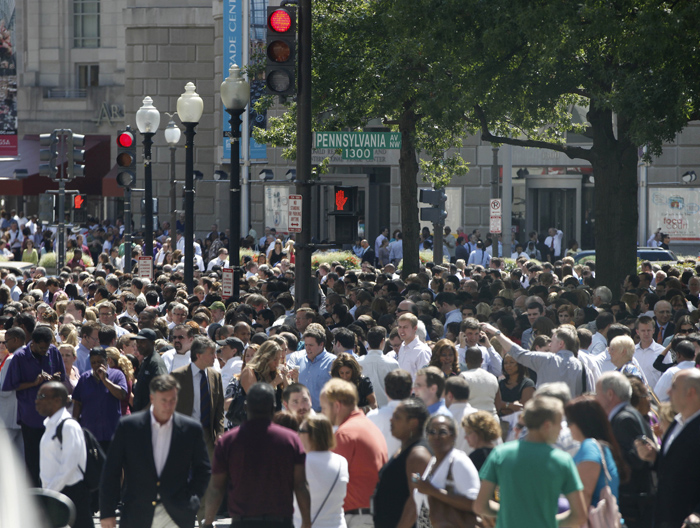 People crowd Pennsylvania Avenue in Washington today, as they evacuate buildings following an earthquake that was centered northwest of Richmond, Va.