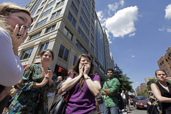 Office workers gather on the sidewalk in downtown Washington today, moments after a 5.9 magnitude tremor shook the nation's capital.