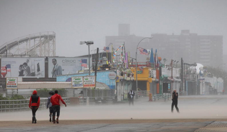 Driving wind and rain lash the Coney Island boardwalk in New York as Irene came closer to the area today. Irene hit Coney Island with 65-mph winds, making it now a tropical storm.