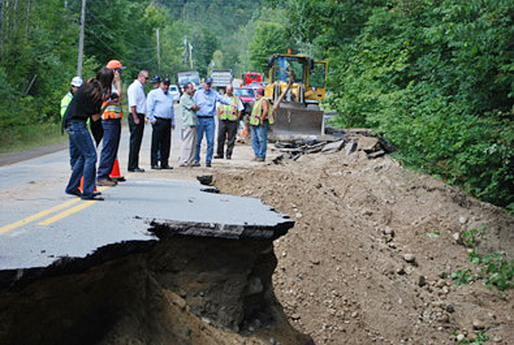 Gov. Paul LePage inspects flood damage in Rumford with Maine Emergency Management Agency Director Robert McAleer and Rumford officials.